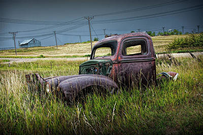 Photograph - Old Rusty Truck Lying In The Grass At The Ghost Town By Okaton South Dakota by Randall Nyhof