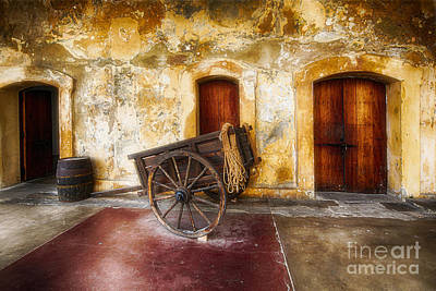 Old Spanish Fort Interior With A Wooden Cart And A Barrel Art Print by George Oze