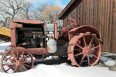Photograph - Old Tractor Against A Barn Wall by Jeff Swan