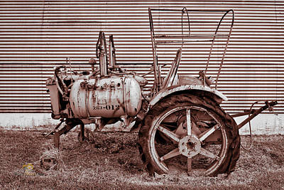 Photograph - Old Tractor Against Quonset Hut by Jim Thompson