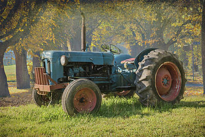 Photograph - Old Tractor On A Country Road by Debra and Dave Vanderlaan