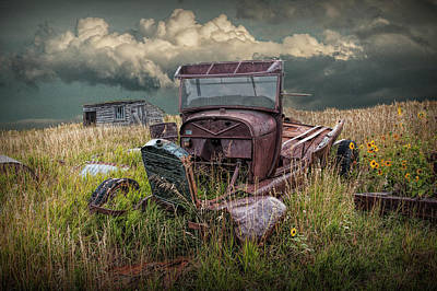 Photograph - Old Truck Abandoned In The Grass At The Ghost Town By Okaton South Dakota by Randall Nyhof
