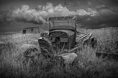 Photograph - Old Truck Abandoned In The Grass In Black And White At The Ghost Town By Okaton South Dakota by Randall Nyhof