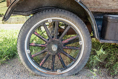 Old Truck Tire In Rural Rocky Mountain Town Art Print by Peter Ciro