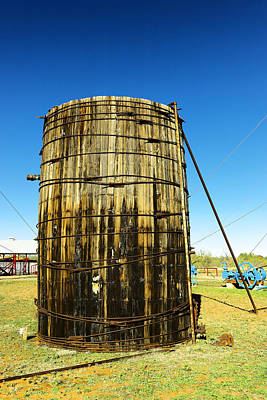 Birds Rights Managed Images - Old upright tank Royalty-Free Image by Jeff Swan