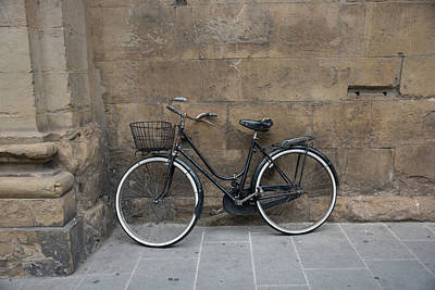 Photograph - Old Vintage Bicycle On Old City Wall Background by Julian Popov