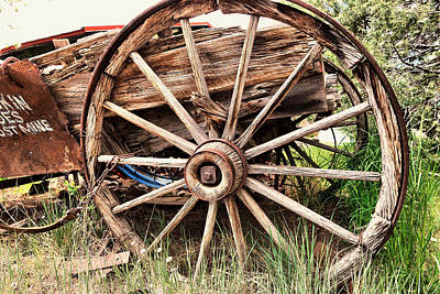 Photograph - Old Wagon Wheel by Jeff Swan