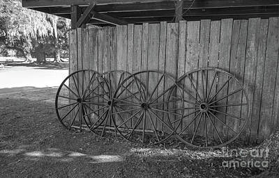 Photograph - Old Wagon Wheels Black And White by Kathy Baccari
