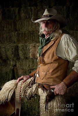 Working Cowboy Photograph - Old West Cowboy With Woolie Chaps And Pistols In Stable by Georgia Evans