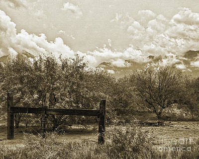 Photograph - Old West Gate And Storm Clouds by Kirt Tisdale