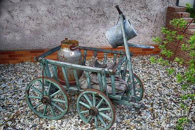 Photograph - Old Wheelbarrow With Milk Churn by Eva-Maria Di Bella
