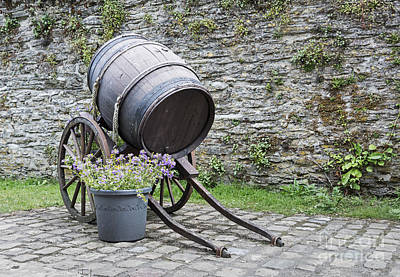 Old Wine Barrel With Wheels  Print by Compuinfoto