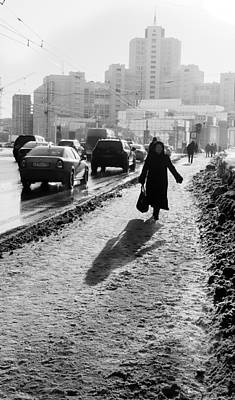 Photograph - Old Woman Walking Snow Street Footpath City by John Williams