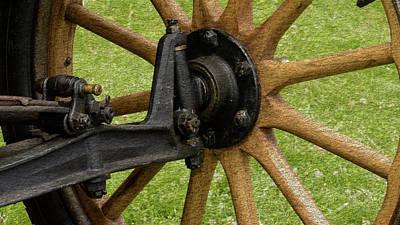 Photograph - Old Wooden Car Wheel And Axle Fine Art by Jacek Wojnarowski