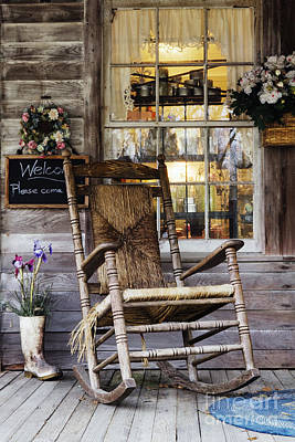 Old Wooden Rocking Chair On A Wooden Porch Art Print by Jeremy Woodhouse