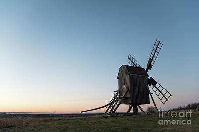 Photograph - Old Wooden Windmill By Evening Light by Kennerth and Birgitta Kullman