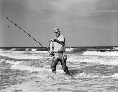 Angling Photograph - Older Man Standing In Surf In Waders by H. Armstrong Roberts/ClassicStock