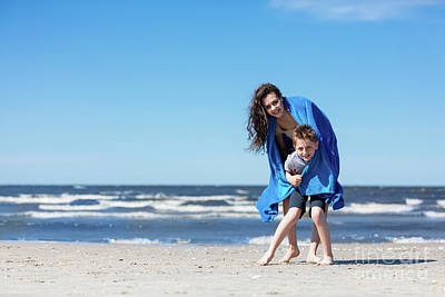 Photograph - Older Sister Holding Her Little Brother On The Beach. by Michal Bednarek