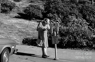 Photograph - Older Woman Paying Parking Meter by Jim Corwin