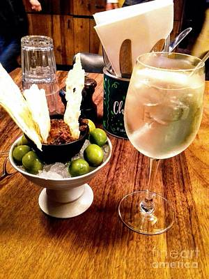 Photograph - Olives On Ice And Prosecco Cocktail by Joan-Violet Stretch