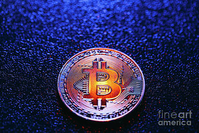 Photograph - One Coin With Bitcoin Logo On A Blue Background by Michal Bednarek