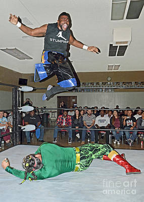Photograph - One Legged Pro Wrestler Hip Hop Harry Henderson Flying Off The Top Ropes by Jim Fitzpatrick