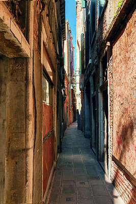 Photograph - one of the many narrow streets of Venice on a Sunny summer day by George Westermak