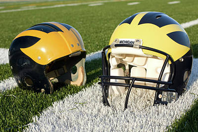 Photograph - One Old, One New Wolverine Helmets On The Field by Michigan Helmet