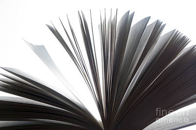 Flutter Photograph - Open Book With Pages Fluttering by Michal Bednarek