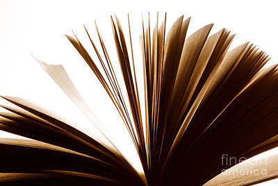 Flutter Photograph - Open Old Book With Pages Fluttering by Michal Bednarek
