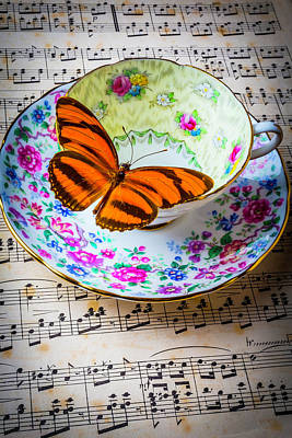 Orange Butterfly On Tea Cup Print by Garry Gay