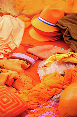 Photograph - Orange Clothing Display At Amsterdam Market by Jenny Rainbow