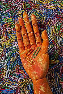 Orange Wooden Hand Holding Paperclips Print by Garry Gay