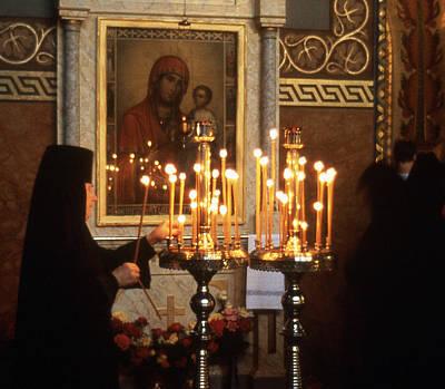 Orthodox Church Georgia Nuns Lighting Prayer Candles Art Print by Richard Singleton