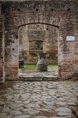Photograph - Ostia Antica - Millstones by Debra Martz