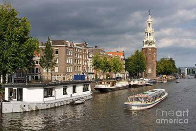 Watercraft Photograph - Oudeschans And Montelbaanstoren. Amsterdam. Netheralnds. Europe by Bernard Jaubert