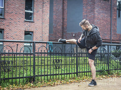 Photograph - Outdoor Streching. Healthy Exercising Habits. by Michal Bednarek