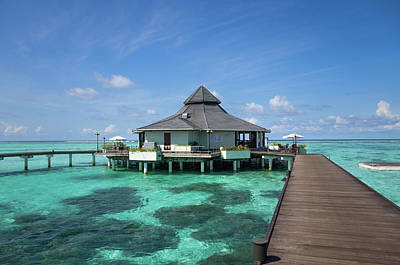 Vacations Photograph - Overwater Restaurant At Maldivian Resort by Jenny Rainbow