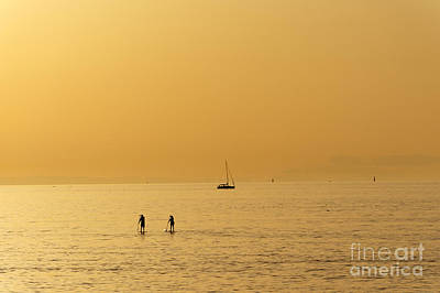 Photograph - Paddle Boarders At Sunset by John  Mitchell