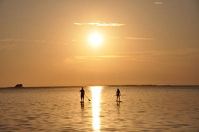 Paddle Boarding Out Of The Sunset Art Print