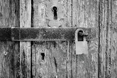 Photograph - Padlock On An Old Wooden Door by Marco Oliveira
