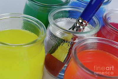 Paintbrush In Water Amongst Multi-colored Glasses Art Print by Sami Sarkis