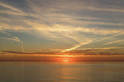 Photograph - Painted By Airplanes - Contrails Streak The Sky At Sunrise by Georgia Mizuleva