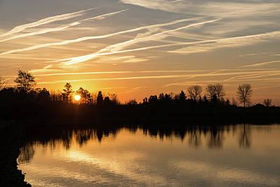 Photograph - Painted By Airplanes - Reflecting On Contrails Streaked Sunrise Sky At The Lake by Georgia Mizuleva