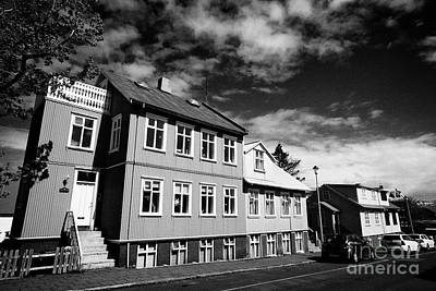 Roofing Tin Photograph - painted corrguated iron tin clad houses in a residential reykjavik Iceland by Joe Fox