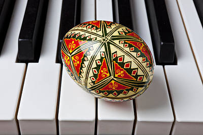Keyboards Photograph - Painted Easter Egg On Piano Keys by Garry Gay