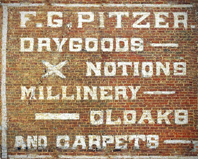 Photograph - Brick Wall Painted Store Sign by Denise Beverly