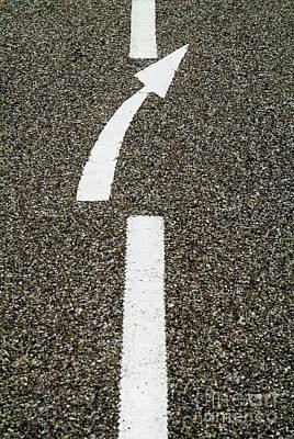 Painted White Arrow Sign In The Dividing Line On The Road Art Print by Sami Sarkis
