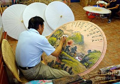 Photograph - Painting Chinese Oil-paper Umbrellas by Yali Shi