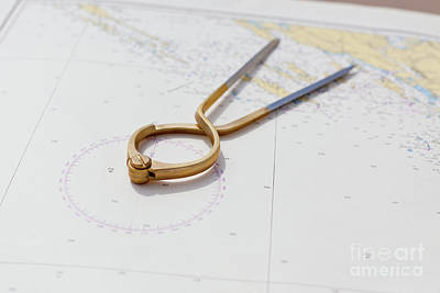 Charting Photograph - Pair Of Compasses For Navigation On A Sea Map by Dvoevnore Photo